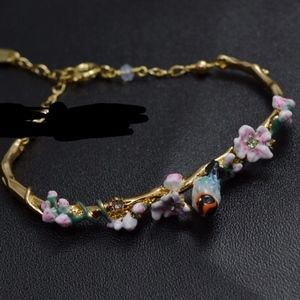 les nereides floral bird bracelet